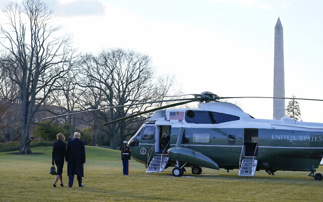 President Donald Trump and first lady Melania Trump walk to board Marine One on the South Lawn of the White House, Wednesday, Jan. 20, 2021, in Washington. Leaving the White House for the last time as president, Trump is en route to his Mar-a-Lago Florida Resort. (AP Photo/Alex Brandon)