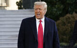 Then-US president Donald Trump speaks with reporters as he walks to board Marine One on the South Lawn of the White House, January 20, 2021, in Washington. (AP Photo/Alex Brandon)