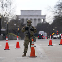 A National Guard stands at a road block near the Supreme Court ahead of President-elect Joe Biden's inauguration ceremony, January 20, 2021, in Washington. (AP Photo/Gerald Herbert)