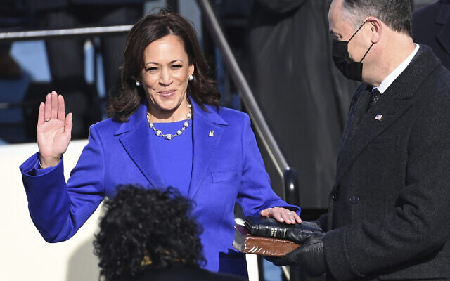 Kamala Harris is sworn in as US vice president by Supreme Court Justice Sonia Sotomayor as her husband Doug Emhoff holds the Bible during the 59th Presidential Inauguration at the US Capitol in Washington on Jan. 20, 2021.(Saul Loeb/Pool Photo via AP)