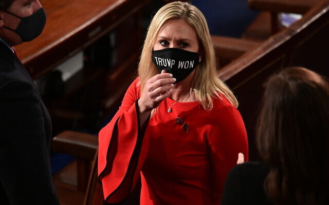 In this Sunday, January 3, 2021, file photo, Rep. Marjorie Taylor Greene, R-Ga., wears a 'Trump Won' face mask as she arrives on the floor of the House to take her oath of office on opening day of the 117th Congress at the US Capitol in Washington. (Erin Scott/Pool Photo via AP)