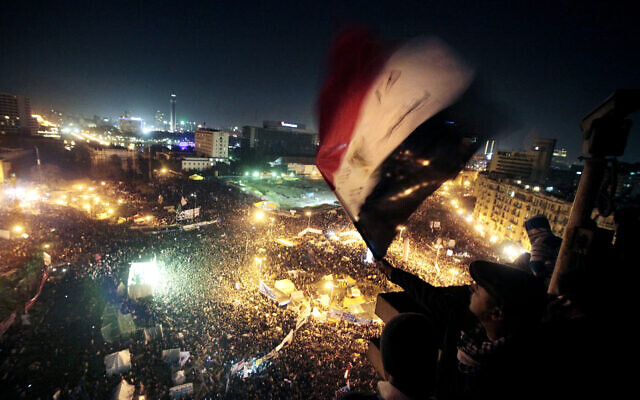 People wave flags in Tahrir Square to mark the first anniversary of the popular uprising that led to the quick ouster of autocrat president Hosni Mubarak, in Cairo, Egypt, January 25, 2012. (AP Photo/Amr Nabil, File)