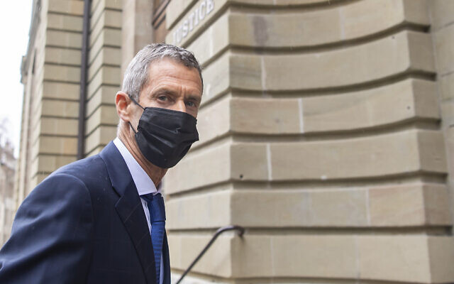 Israeli businessman Beny Steinmetz arrives at Geneva's courthouse for the reading of his verdict for alleged corruption of Guinean public officials and forgery documents, in Geneva, Switzerland, Jan. 22, 2021. (Martial Trezzini/Keystone via AP)