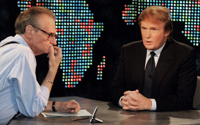 "In this Oct. 7, 1999 photo, Donald Trump is interviewed by Larry King during a taping of ""Larry King Live,""  in New York. (AP Photo/Marty Lederhandler, File)"