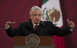 In this Dec. 18, 2020 file photo, Mexican President Andres Manuel Lopez Obrador gives his daily, morning news conference at the presidential palace, Palacio Nacional, in Mexico City. Mexico President Andrés Manuel López Obrador says he has tested positive for COVID-19 and is under medical treatment, Sunday, Jan. 24, 2021. (AP Photo/Marco Ugarte, File)