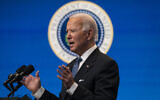 US President Joe Biden answers questions from reporters in the South Court Auditorium on the White House complex, Monday, Jan. 25, 2021, in Washington. (AP Photo/Evan Vucci)