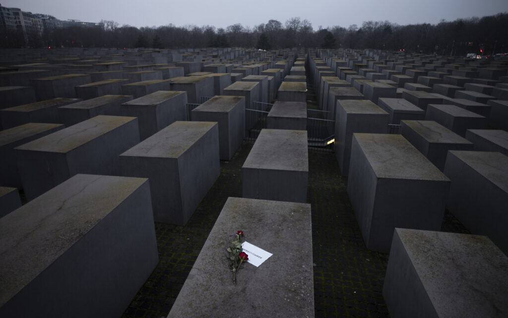 """Roses with a note saying """"#weremember"""" are placed on the Holocaust Memorial on International Holocaust Remembrance Day, in Berlin, Germany, January 27, 2021. (AP Photo/Markus Schreiber)"""