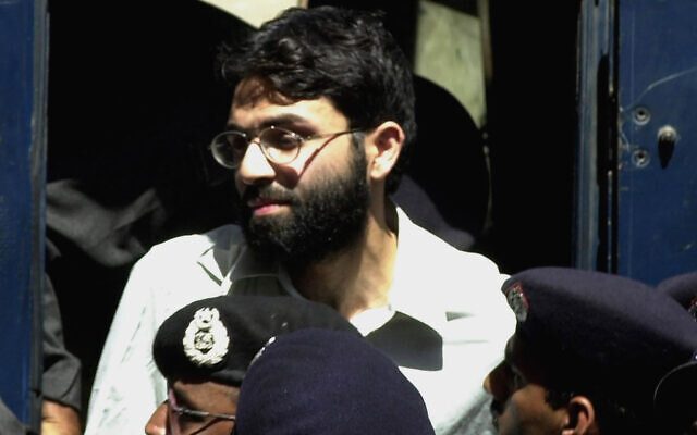 Ahmed Omar Saeed Sheikh, the alleged mastermind behind Wall Street Journal reporter Daniel Pearl's kidnap-slaying, appears at the court in Karachi, Pakistan, March 29, 2002. (Zia Mazhar/AP)