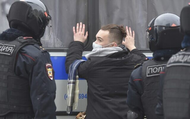 Police detain a man during a protest against the jailing of opposition leader Alexei Navalny in Moscow, Russia, January 31, 2021. (Dmitry Serebryakov/AP)