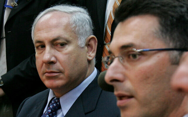 Benjamin Netanyahu and Gideon Sa'ar at a Likud faction meeting in the Knesset, on November 21, 2005. (AP Photo/Oded Balilty)