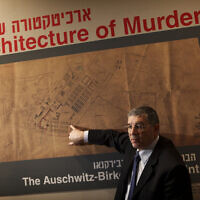 File photo: Yad Vashem chairman Avner Shalev speaks during a presentation to the media before the opening of an exhibition, showing the blueprints of the Nazi death camp of Auschwitz, at the Yad Vashem Holocaust memorial in Jerusalem, January 24, 2010. (AP Photo/Dan Balilty)