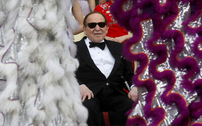 Las Vegas Sands Chairman and CEO Sheldon Adelson watches a lion dance at the opening ceremony of the Sands Cotai Central in Macau, April 12, 2012. (AP Photo/Kin Cheung)