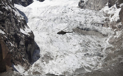Illustrative -- A Pakistan Army helicopter flies over the site of an avalanche over Gayari camp, April 18, 2012 (AP Photo/B.K. Bangash)