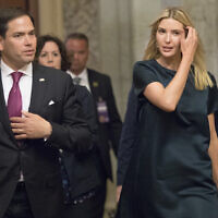 Ivanka Trump, daughter of and adviser to President Donald Trump, is escorted by Sen. Marco Rubio as she arrives at the Capitol to meet with lawmakers about parental leave, in Washington, Tuesday, June 20, 2017. (AP Photo/J. Scott Applewhite)