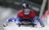 Adam Edelman of Israel brakes in the finish area during the men's skeleton training at the 2018 Winter Olympics in Pyeongchang, South Korea, February 14, 2018. (AP Photo/Michael Sohn)