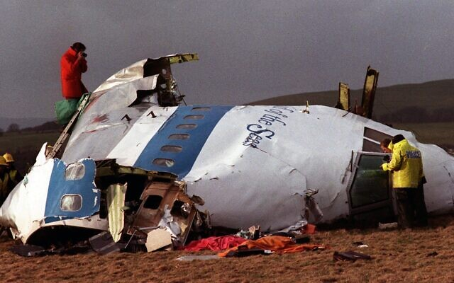 In this Dec 22, 1988 file photo police and investigators look at what remains of the flight deck of Pan Am 103 in a field in Lockerbie, Scotland. In 1988, 270 people were killed when a terrorist bomb exploded aboard a Pam Am Boeing 747 over Lockerbie, Scotland, sending wreckage crashing to the ground. (AP Photo/File)