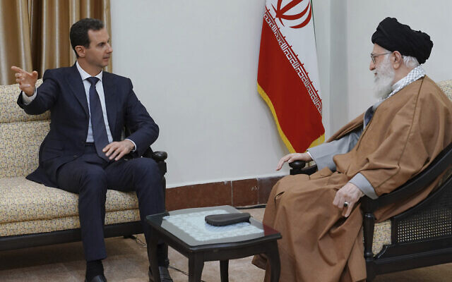 In this photo released by the Syrian official news agency SANA, Syrian President Bashar Assad, left, speaks with Iranian Supreme Leader Ayatollah Ali Khamenei, before their meeting in Tehran, Syria, Monday, Feb. 25, 2019. erupted nearly eight years ago. (SANA via AP)