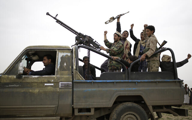 Houthi fighters chant slogans as they take off to a battlefront following a gathering aimed at mobilizing more fighters for the Houthi movement, in Sanaa, Yemen, August 1, 2019. (AP Photo/Hani Mohammed)