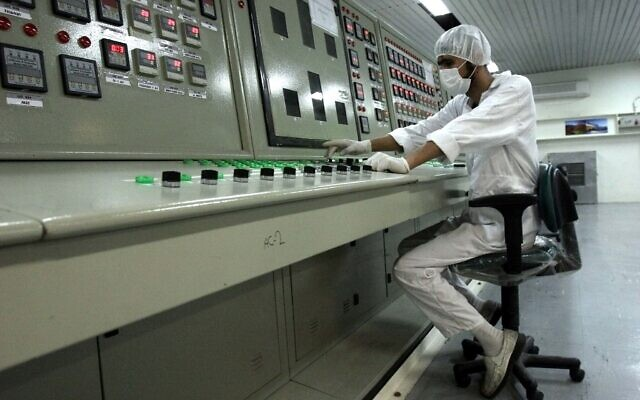 In this Feb. 3, 2007 file photo, a technician works at the Uranium Conversion Facility just outside the city of Isfahan, Iran. (AP Photo/Vahid Salemi, File)