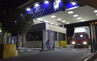 A truck containing cylinder of uranium hexafluoride gas leaves Ahmadi Roshan uranium enrichment facility in Natanz to Fordo nuclear facility for the purpose of injecting the gas into Fordo centrifuges, November 6, 2019. (Atomic Energy Organization of Iran via AP)