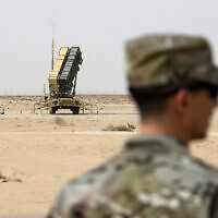 A member of the US Air Force stands near a Patriot missile battery at the Prince Sultan air base in al-Kharj, central Saudi Arabia, February 20, 2020 (Andrew Caballero-Reynolds/Pool via AP)
