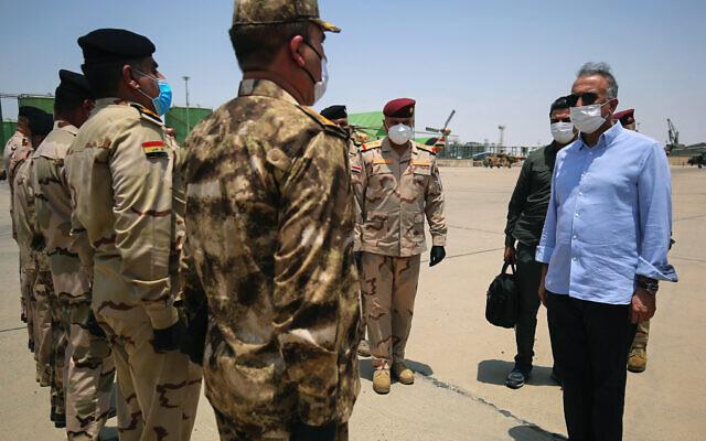 Iraq's Prime Minister Mustafa al-Kadhimi, right, arrives in Basra, Iraq on July 15, 2020. (Ahmed al-Rubaye/Pool Photo via AP)
