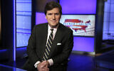 Tucker Carlson, host of 'Tucker Carlson Tonight,' poses for photos in a Fox News Channel studio, March 2, 2017 in New York (AP Photo/Richard Drew, File)