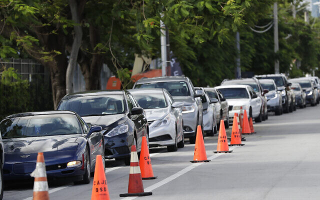 Illustrative: A line of cars wait at the entrance to a kosher food drive-thru distribution site, July 29, 2020, at the Greater Miami Jewish Federation building in Miami. (AP Photo/Wilfredo Lee)