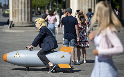 Illustrative: An activist dressed up as US President Trump rides a atomic bomb model during a protest for a world without nuclear weapons near the Brandenburg Gate in Berlin, Germany, July 30, 2020.  (Fabian Sommer/dpa via AP)