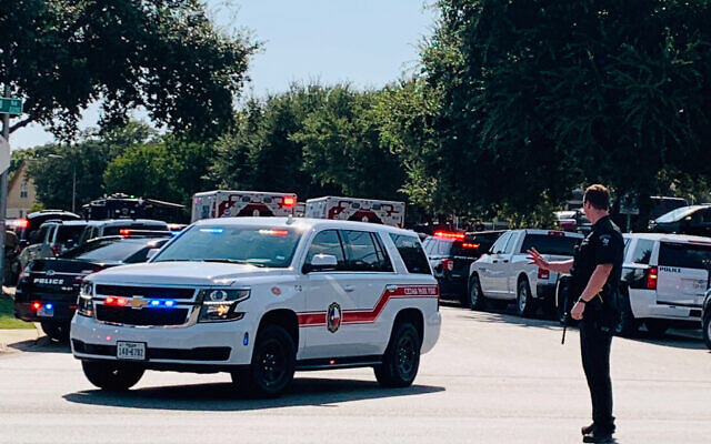 Illustrative: Police and other emergency vehicles are gathered near where three police officers were shot Sunday, Aug. 16, 2020 in Cedar Park, Texas.  (Andy Way/KXAN-TV via AP)