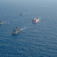 Turkey's research vessel, Oruc Reis, center, is surrounded by Turkish navy vessels in the Mediterranean Sea, August 10, 2020. (IHA via AP)