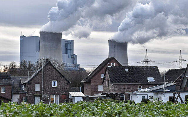 In this January 13, 2020, photo RWE lignite-fired power station releases steam in Bergheim, Germany (AP Photo/Martin Meissner)