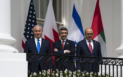 Prime Minister Benjamin Netanyahu, left; United Arab Emirates Foreign Minister Abdullah bin Zayed al-Nahyan; and Bahrain Foreign Minister Khalid bin Ahmed Al Khalifa; at the White House, Sept. 15, 2020. (AP Photo/Alex Brandon)