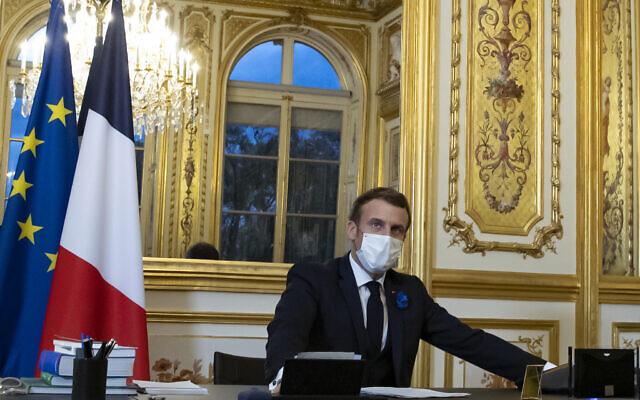 Illustrative: French President Emmanuel Macron speaks on the telephone to US President-elect Joe Biden, at the Elysee Palace in Paris, Tuesday, Nov. 10, 2020. (Ian Langsdon, Pool via AP)
