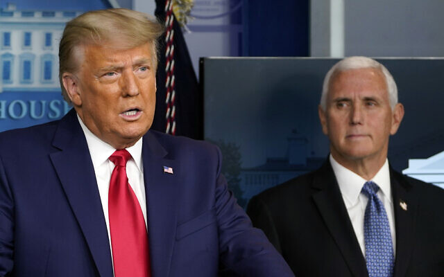 US President Donald Trump speaks in the press briefing room as Vice President Mike Pence listens, November 24, 2020, in Washington. (AP Photo/Susan Walsh)