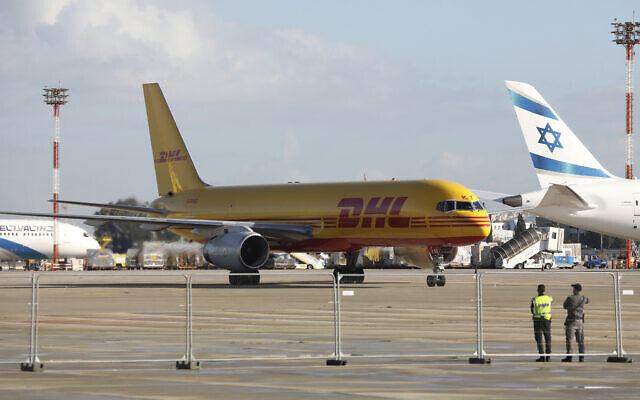 File: A plane of the international courier company DHL, carrying over 100,000 doses of the first batch of Pfizer coronavirus vaccines, lands at Ben Gurion Airport near Tel Aviv, Wednesday, Dec. 9, 2020 (Abir Sultan/Pool Photo via AP)