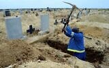 A grave digger prepares graves at the Motherwell Cemetery in Port Elizabeth, South Africa, Friday, Dec. 4, 2020 (AP Photo/Theo Jeftha)