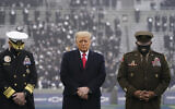 In this Dec. 12, 2020, file photo US President Donald Trump stands on the field before the 121st Army-Navy Football Game in Michie Stadium at the United States Military Academy in West Point, N.Y.  (AP Photo/Andrew Harnik, File)