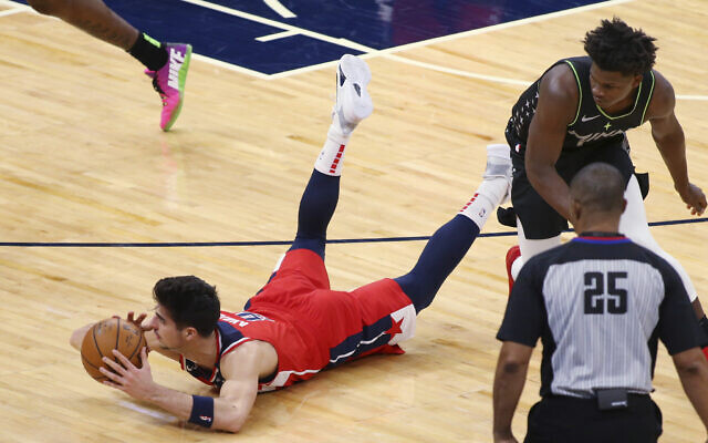 Washington Wizards forward Deni Avdija (9) dives for the ball next to Minnesota Timberwolves guard Anthony Edwards during the first quarter of an NBA basketball game Jan. 1, 2021, in Minneapolis. (AP Photo/Andy Clayton-King)