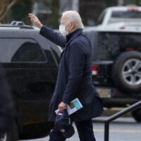 President-elect Joe Biden waves as he walks from St. Edmond Catholic Church after attending Mass in Rehoboth Beach, Del., January 3, 2021. (AP Photo/Carolyn Kaster)