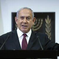 In this Dec. 22, 2020 file photo, Prime Minister Benjamin Netanyahu delivers a statement at the Knesset in Jerusalem (Yonatan Sindel/Pool Photo via AP, File)