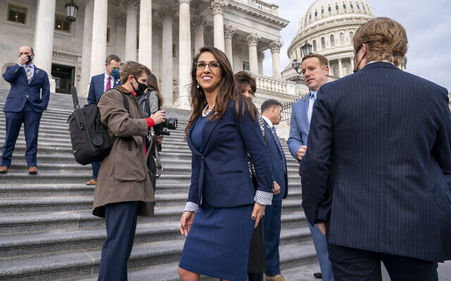 Representative Lauren Boebert of Colorado, center, smiles after joining other freshman Republican House members for a group photo at the Capitol in Washington, January 4, 2021. (AP Photo/J. Scott Applewhite)