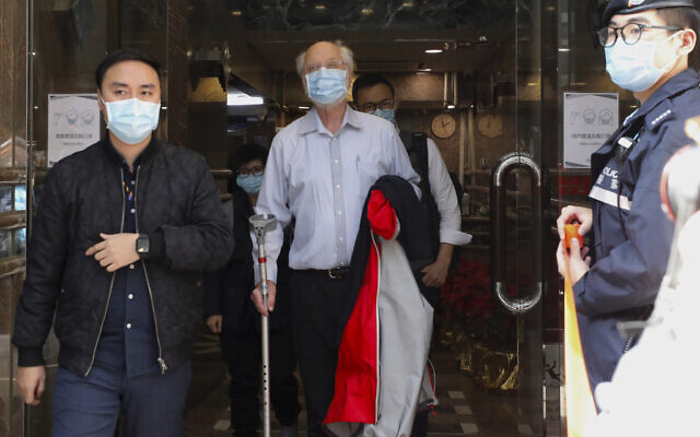 American human rights lawyer John Clancey, center, is arrested by police in Hong Kong, January 6, 2021. (Apple Daily/AP)