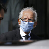 Mehmood A. Sheikh, defense lawyer for British-born Pakistani Ahmed Omar Saeed Sheikh, leaves the Supreme Court after an appeal hearing in the Daniel Pearl case, in Islamabad, Pakistan, January 6, 2021. (AP Photo/Anjum Naveed)
