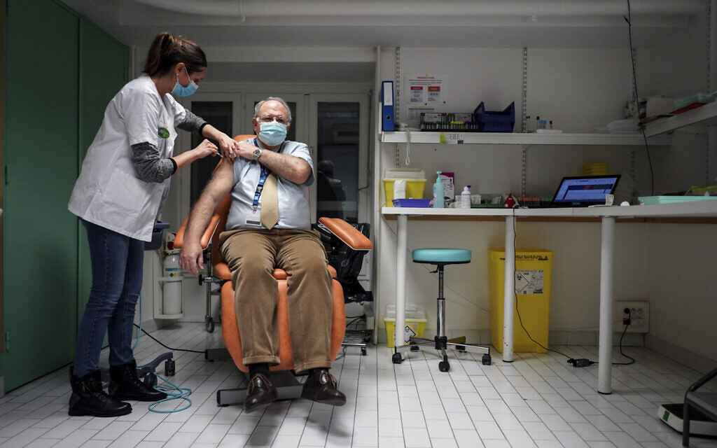 Dr. Christian Chidiac gets a Pfizer-BioNTech COVID-19 vaccine in La Croix-Rousse hospital, in Lyon, central France, Wednesday Jan. 6, 2021 (AP Photo/Laurent Cipriani)