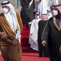Saudi Arabia's Crown Prince Mohammed bin Salman, right, welcomes Qatar's Emir Sheikh Tamim bin Hamad al-Thani upon his arrival in Al-Ula, Saudi Arabia, January 5, 2021. (Saudi Royal Court via AP, File)