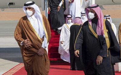 Saudi Arabia's Crown Prince Mohammed bin Salman, right, welcomes Qatar's Emir Sheikh Tamim bin Hamad al-Thani upon his arrival in Al-Ula, Saudi Arabia, January 5, 2021. (Saudi Royal Court via AP, File)