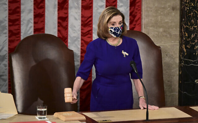 US Speaker of the House Nancy Pelosi bangs the Speaker's gavel as a joint session of the House and Senate convenes to confirm the Electoral College votes cast in November's election, at the Capitol in Washington, Wednesday, Jan. 6, 2021 (Erin Scott/Pool via AP)