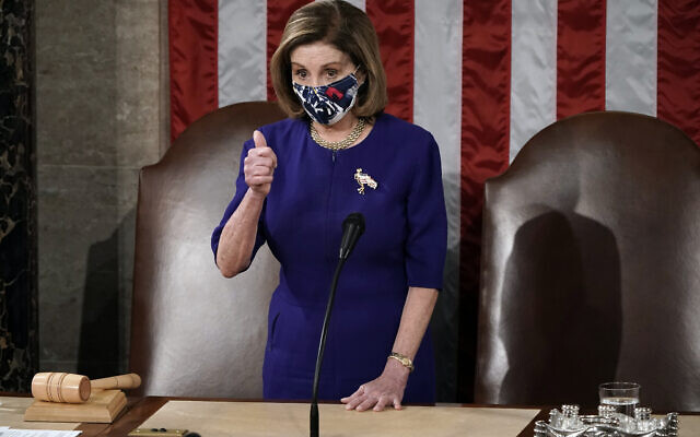US Speaker of the House Nancy Pelosi, D-Calif., arrives as a joint session of the House and Senate convenes to count the Electoral College votes cast in November's election, at the Capitol in Washington, Wednesday, Jan. 6, 2021. (AP Photo/J. Scott Applewhite)