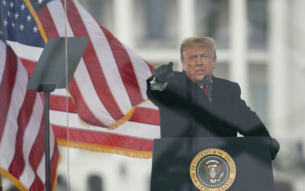 Then-US president Donald Trump speaks during a rally protesting the electoral college certification of Joe Biden as president, shortly before the assault on the US Capitol, Wednesday, January 6, 2021, in Washington. (AP Photo/Evan Vucci)
